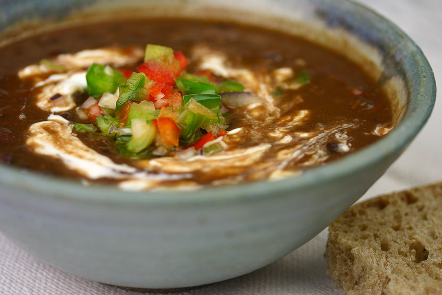 Traditional Cuban black bean soup is made with a ham hock, which is ...